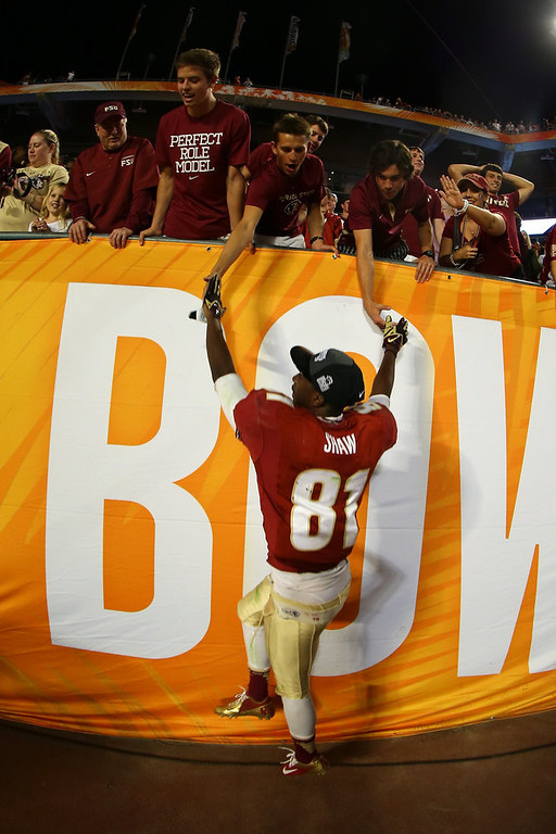 Description of . Kenny Shaw #81 of the Florida State Seminoles celebrates with fans after they won 31-10 against the Northern Illinois Huskies during the Discover Orange Bowl at Sun Life Stadium on January 1, 2013 in Miami Gardens, Florida.  (Photo by Mike Ehrmann/Getty Images)