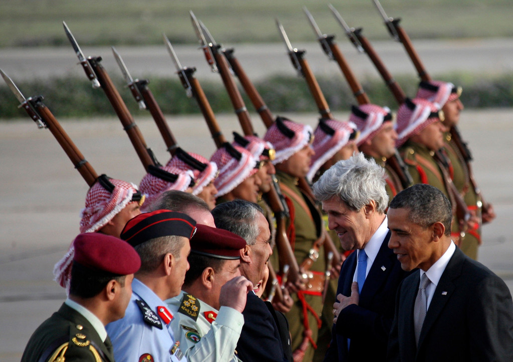 Description of . U.S. President Barack Obama (R) and U.S. Secretary of State John Kerry (2nd R) are  greeted by Jordanian officials upon their arrival at Amman airport March 22, 2013.   REUTERS/Ali Jarekji