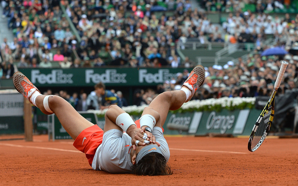 Description of . Spain's Rafael Nadal celebrates as he wins the 2013 French tennis Open final against Spain's David Ferrer at the Roland Garros stadium in Paris on June 9, 2013.    ALEXIS REAU/AFP/Getty Images