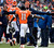 Denver Broncos wide receiver Trindon Holliday (11) celebrates with Denver Broncos head coach John Fox after scoring a touchdown on an 89 yard punt return early in the first quarter.  The Denver Broncos vs Baltimore Ravens AFC Divisional playoff game at Sports Authority Field Saturday January 12, 2013. (Photo by John Leyba,/The Denver Post)
