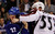 Vancouver Canucks' Dale Weise (L) gets punched in the face by Cody McLeod of the Colorado Avalanche during the first period of their NHL hockey game in Vancouver, British Columbia January 30, 2013. REUTERS/Ben Nelms