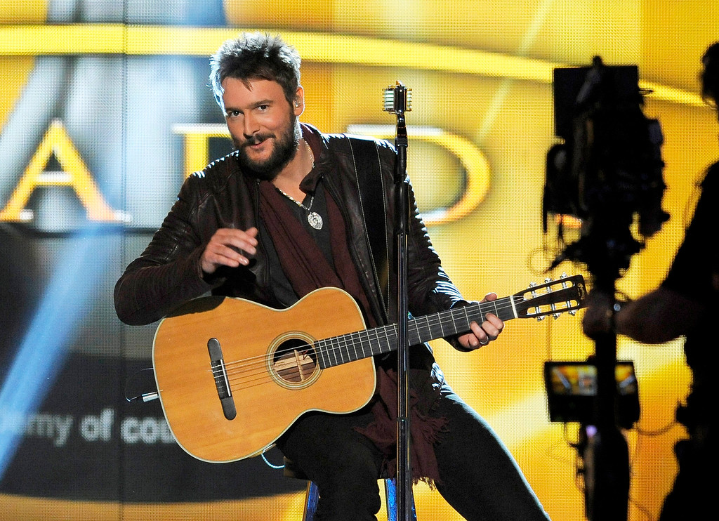 Description of . FILE  - In this April 7, 2013 file photo, singer Eric Church performs at the 48th Annual Academy of Country Music Awards at the MGM Grand Garden Arena in Las Vegas. Most performers stick to the script and promote their latest single on awards shows. Not Church. Mainstream country's hardest rocker is taking a typically different approach, inviting Lzzy Hale of Halestorm to appear with him on the CMT Music Awards on Wednesday, June 4, 2014.  (Photo by Chris Pizzello/Invision/AP, File)