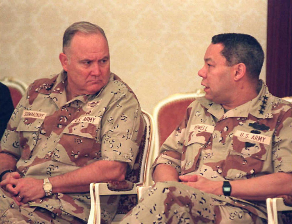 Description of . Picture dated 23 Dec 90 of US Army General Norman Schwarzkopf (l) speaking with Commander of the U.S Forces in Saudi Arabia, General Colin Powell.         BOB SULLIVAN/AFP/Getty Images