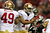 Quarterback Colin Kaepernick #7 of the San Francisco 49ers reacts in the first half against the Atlanta Falcons in the NFC Championship game at the Georgia Dome on January 20, 2013 in Atlanta, Georgia.  (Photo by Mike Ehrmann/Getty Images)