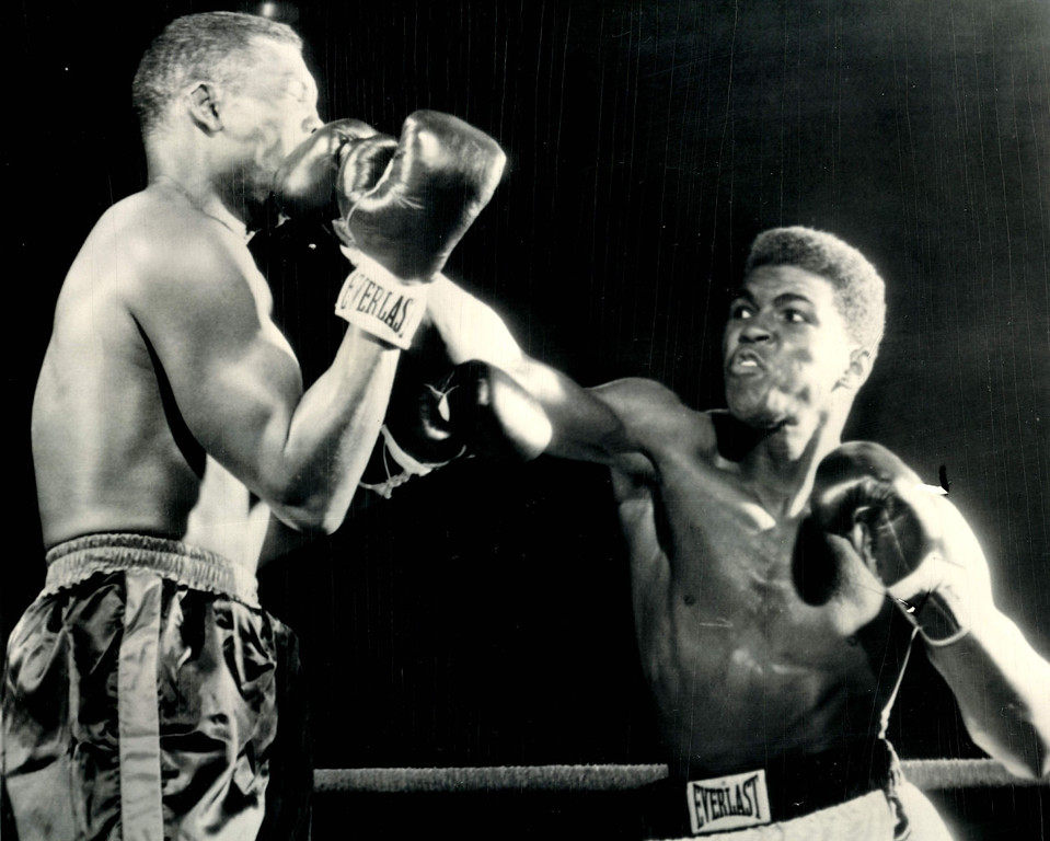 Description of . Cassius Clay (right) lands on Don Warner\'s jaw in an early exchange of their fight tonight with a straight right--the same punch which knocked Warner through the ropes in Round 4 and headed him for a technical knockout as the fight was stopped soon after he climbed back to the canvas. 1962  Credit: AP