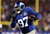 Linval Joseph #97 of the New York Giants recovers a fumble and carries the ball in the first quarter against the New Orleans Saints on December 9, 2012 at MetLife Stadium in East Rutherford, New Jersey.  (Photo by Elsa/Getty Images)