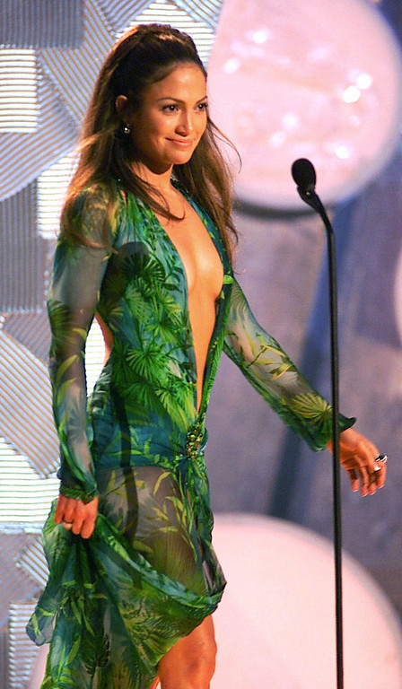 Description of . Jennifer Lopez, perhaps the evening's most-talked-about celebrity with a gown cut in a loose V that left little to the imagination, appears on-stage during the 42nd Grammy Awards at the Staples Center in Los Angeles, Wednesday, Feb. 23, 2000. (AP Photo/Kevork Djansezian).