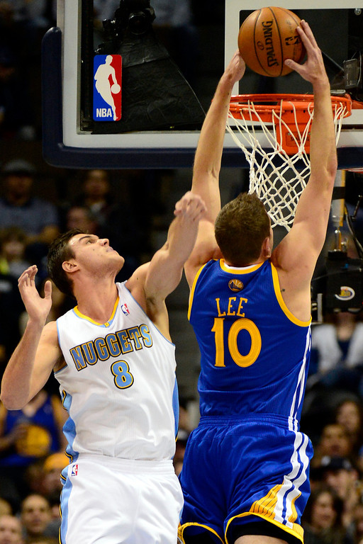 Description of . Golden State Warriors power forward David Lee (10) dunks over Denver Nuggets small forward Danilo Gallinari (8) during the first half at the Pepsi Center on Sunday, January 13, 2013. AAron Ontiveroz, The Denver Post
