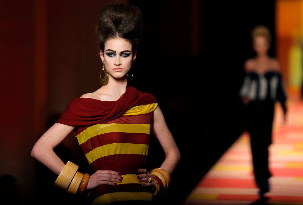 Description of . A model presents a creation for French fashion fashion designer Jean-Paul Gaultier's Spring-Summer 2013 Haute Couture fashion collection, presented in Paris, Wednesday, Jan.23, 2013. (AP Photo/Jacques Brinon)