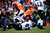 Denver Broncos quarterback Peyton Manning (18) is taken down by Baltimore Ravens defensive end Arthur Jones (97) after releasing the ball in the first quarter. The Denver Broncos vs Baltimore Ravens AFC Divisional playoff game at Sports Authority Field Saturday January 12, 2013. (Photo by AAron  Ontiveroz,/The Denver Post)