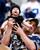 A young New Orleans Saints fan is held by a Dallas Cowboys fan during the second half of an NFL football game on Sunday, Dec. 23, 2012, in Arlington, Texas. (AP Photo/Sharon Ellman)
