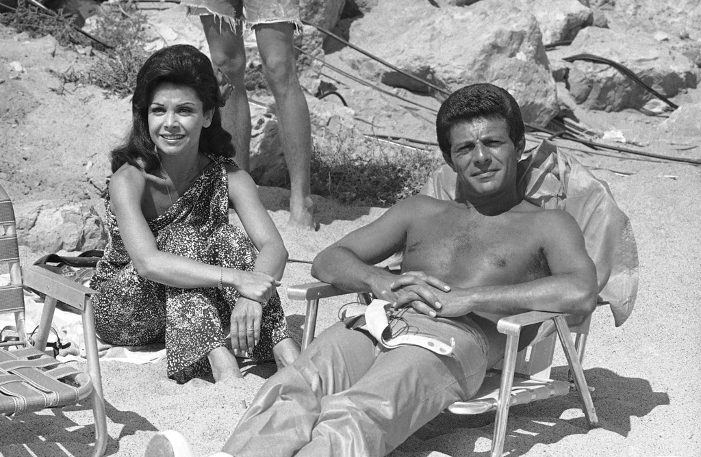 Description of . Working together again after a separation of ten years Frankie Avalon and Annette Funicello chat during a break in the filming of another beach movie in Los Angeles, Aug. 26, 1977.  (AP Photo/Jeff Robbins)