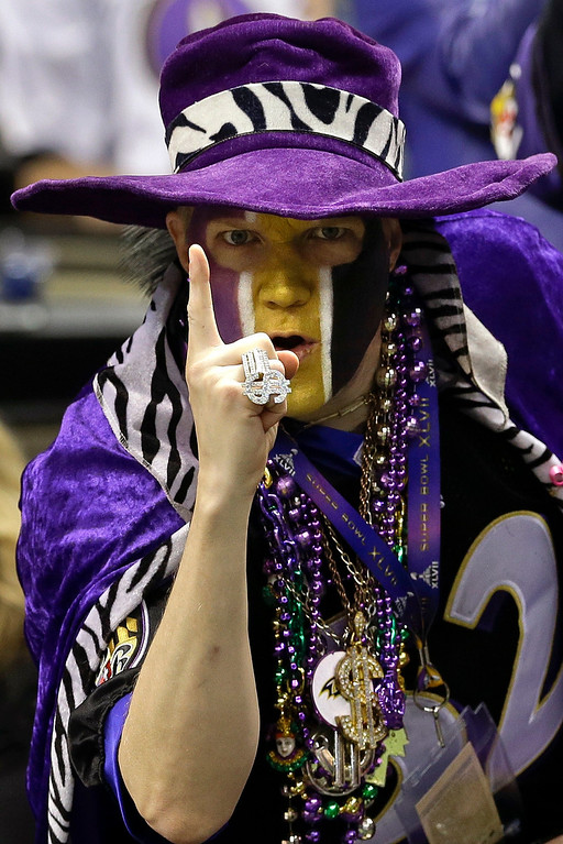 Description of . Chris Newton, of Alexandria, Va., poses for a photo before the NFL Super Bowl XLVII football game between the Baltimore Ravens and the San Francisco 49ers, Sunday, Feb. 3, 2013, in New Orleans. (AP Photo/Patrick Semansky)