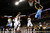 Denver Nuggets center JaVale McGee (R) works to shoot over Charlotte Bobcats small forward Michael Kidd-Gilchrist (14) during the first half of their NBA basketball game in Charlotte, North Carolina February 23, 2013. REUTERS/Chris Keane