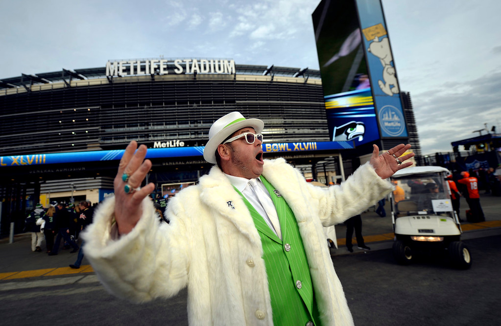 Description of . Shannon Love of Seattle, Washington poses for the passing crowd heading into the stadium prior to the game.  The Denver Broncos vs the Seattle Seahawks in Super Bowl XLVIII at MetLife Stadium in East Rutherford, New Jersey Sunday, February 2, 2014. (Photo by Hyoung Chang//The Denver Post)