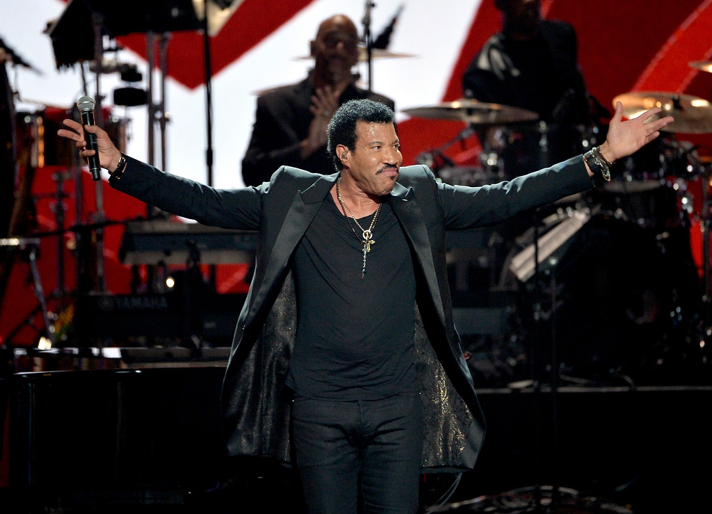 Description of . Singer Lionel Richie performs onstage during the BET AWARDS '14 at Nokia Theatre L.A. LIVE on June 29, 2014 in Los Angeles, California.  (Photo by Kevin Winter/Getty Images for BET)
