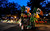 A street vendor rolls his cart along the parade route at dawn before Savannahs 189-year-old St. Patricks Day parade, Saturday, March 16, 2013, in Savannah, Ga. (AP Photo/Stephen Morton)