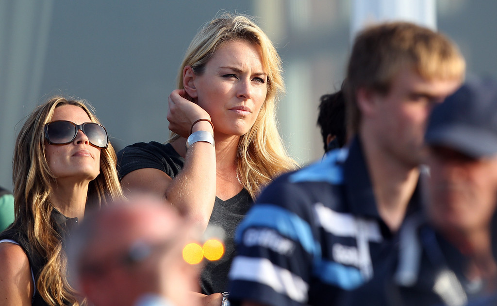 Description of . US Olympic Skier Lindsey Vonn watches her boyfriend US golfer Tiger Woods play during the third round of the 2013 British Open Golf Championship at Muirfield golf course at Gullane in Scotland on July 20, 2013 . PETER MUHLY/AFP/Getty Images