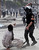 A riot policeman uses his baton on a protester opposing Egyptian President Mohamed Mursi, during clashes along Qasr Al Nil bridge, which leads to Tahrir Square in Cairo January 28, 2013. Monday was the fifth day of violence in Egypt that has killed 50 people and prompted the Islamist president to declare a state of emergency in an attempt to end a wave of unrest sweeping the Arab world's biggest nation. REUTERS/Amr Abdallah Dalsh