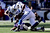 T.Y. Hilton #13 of the Indianapolis Colts is tripped up by Cary Williams #29 of the Baltimore Ravens as Hilton ran for yards after the catch in the first half during the AFC Wild Card Playoff Game at M&T Bank Stadium on January 6, 2013 in Baltimore, Maryland.  (Photo by Rob Carr/Getty Images)
