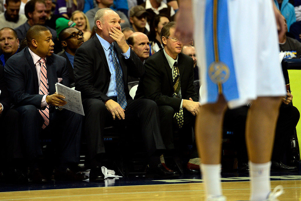 Description of . Denver Nuggets head coach George Karl reacts to a foul call on shooting guard Andre Iguodala (9) during the second half of the Nuggets' 126-114 win at the Pepsi Center on Wednesday, December 26, 2012. AAron Ontiveroz, The Denver Post
