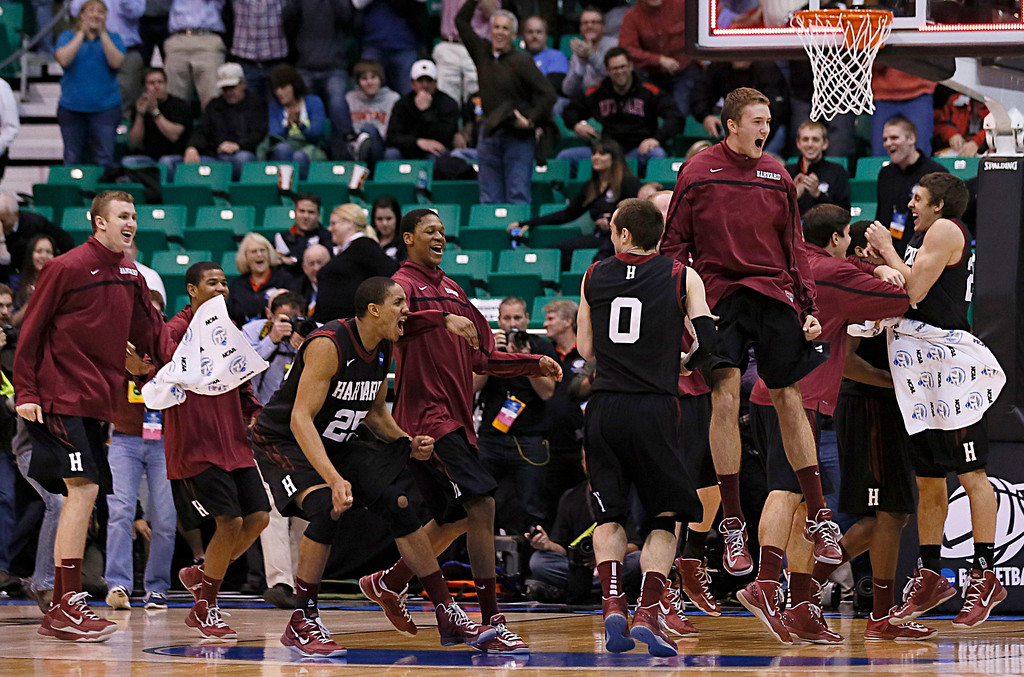 . Harvard players run off the bench and celebrate after beating New Mexico during a second round game in the NCAA college basketball tournament in Salt Lake City Thursday, March 21, 2013. Harvard beat New Mexico 68-62. (AP Photo/George Frey)