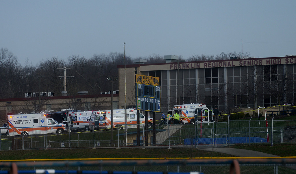 Description of . Emergency responders gather at the high school on the campus of the Franklin Regional School District, where several people were stabbed at Franklin Regional High School, Wednesday, April 9, 2014, in Murrysville, Pa., near Pittsburgh. The suspect, a male student, was taken into custody and being questioned. (AP Photo/Tribune Review, Sean Stipp)