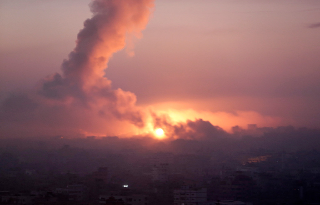 Description of . Smoke rises in the sky following Israeli strikes on eastern Gaza City, early Wednesday, July 30, 2014, amid Israel's heaviest air and artillery assault in more than three weeks of Israel-Hamas fighting. (AP Photo/Khalil Hamra)