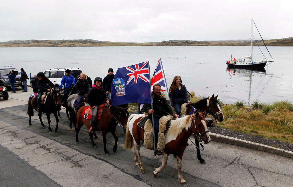 Description of . Falkland islanders ride their horses during a parade in Stanley, March 10, 2013. Voters in the remote British-ruled Falkland Islands hold a referendum on their future today that seeks to challenge Argentina's increasingly vocal sovereignty claim. REUTERS/Marcos Brindicci