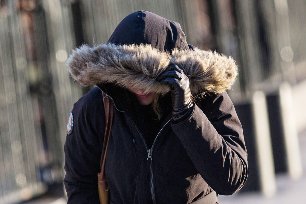 Description of . A woman bundles up against the cold on the morning of January 7, 2014 in New York, United States. A polar vortex has descended on much of North America, coming down from the Arctic, bringing record freezing temperatures across much of the country.  (Photo by Andrew Burton/Getty Images)