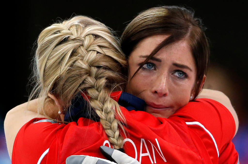 Description of . Britain's skip Eve Muirhead, right, embraces Anna Sloan after defeating Switzerland to win the women's curling bronze medal at the 2014 Winter Olympics, Thursday, Feb. 20, 2014, in Sochi, Russia. (AP Photo/Robert F. Bukaty)