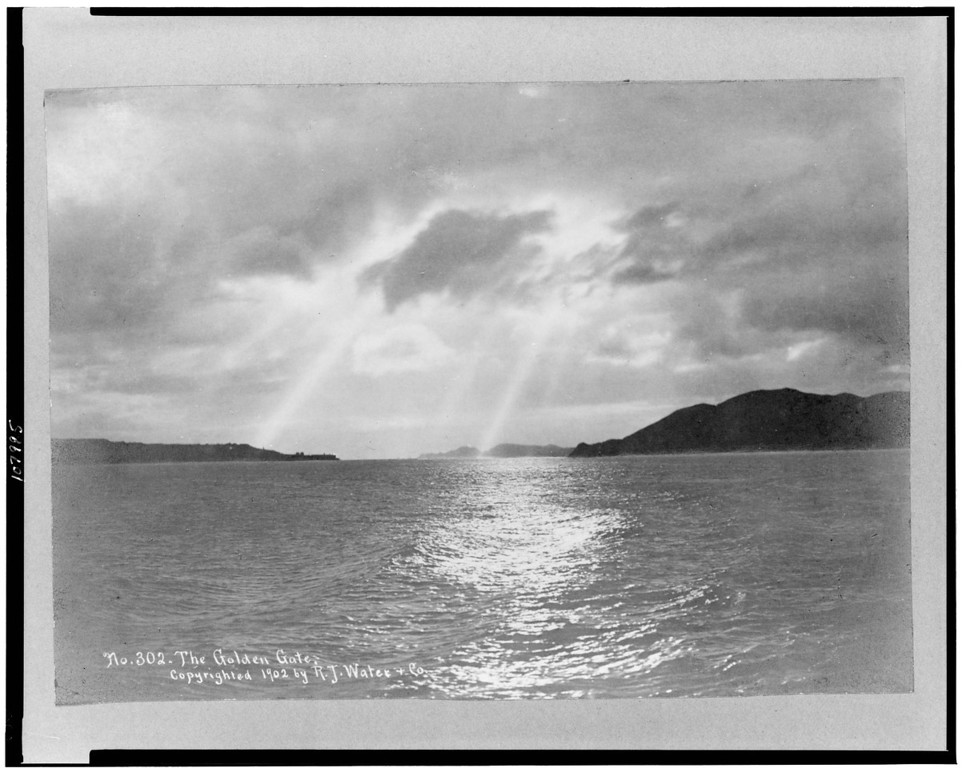 Description of . View of the San Francisco Bay before the Golden Gate Bridge was built with sun shining through clouds on water, c1902. (Library of Congress)