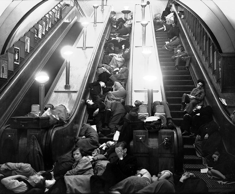Description of . Londoners sleep on stationary escalators in a London Underground station during Nazi bombing raids on Sept. 27, 1940. (AP Photo)