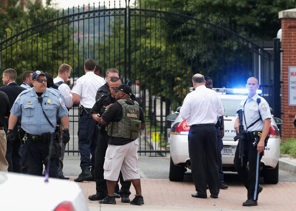 Description of . Law enforcement personnel respond to a reported shooting at an entrance to the Washington Navy Yard September 16, 2013 in Washington, DC. According to news reports several people were shot with a shooter still active.   (Photo by Alex Wong/Getty Images)