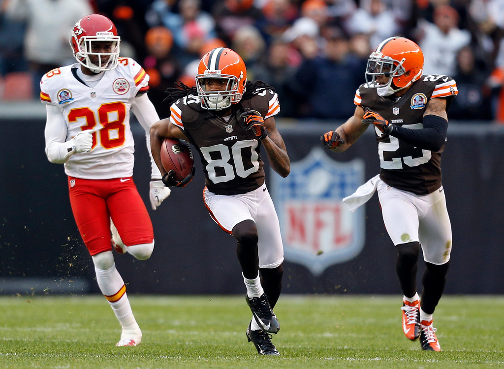 Description of . Cleveland Browns wide receiver Travis Benjamin (80) breaks away from Kansas City Chiefs cornerback Neiko Thorpe (38) on a 93-yard punt return for a touchdown in the second quarter of an NFL football game in Cleveland, Sunday, Dec. 9, 2012. Browns cornerback Joe Haden (23) blocks on the return. (AP Photo/Rick Osentoski)