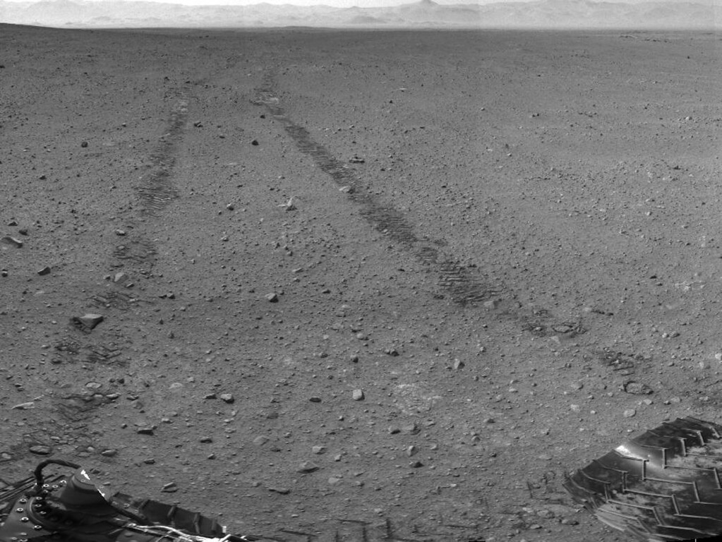 Description of . FILE - This image provided by NASA/JPL-Caltech shows the surroundings of the location where NASA Mars rover Curiosity arrived on Sept. 4, 2012. It is a mosaic of images taken by Curiosity's Navigation Camera (Navcam) following the Sol 29 drive of 100 feet. About 9 feet apart, tracks from the drive are visible in the image. (AP Photo/NASA/JPL-Caltech)