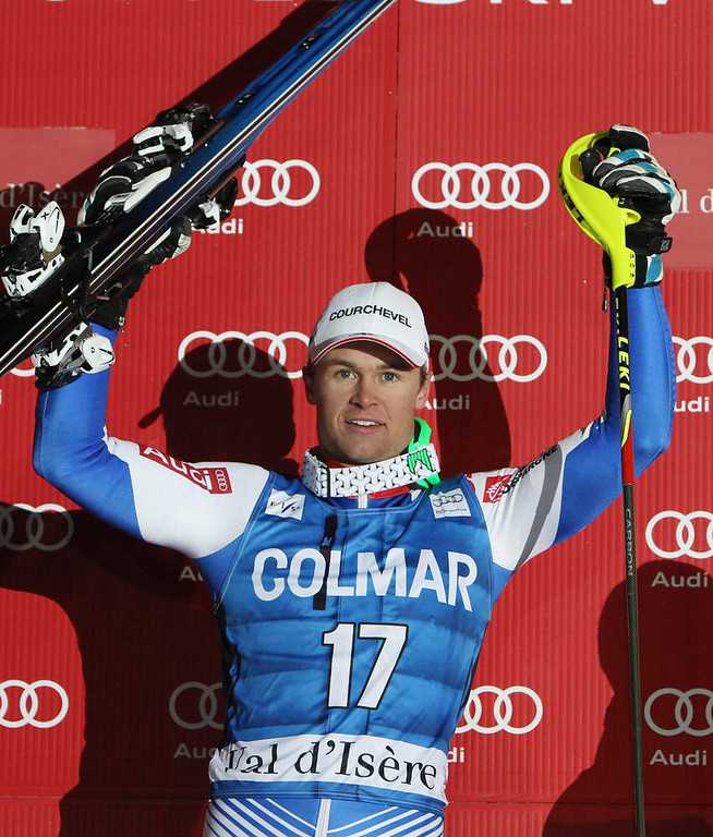 Description of . France's Alexis Pinturault celebrates on podium after winning an alpine ski, men's World Cup slalom in Val d'Isere, France, Saturday, Dec. 8, 2012. (AP Photo/Alessandro Trovati)