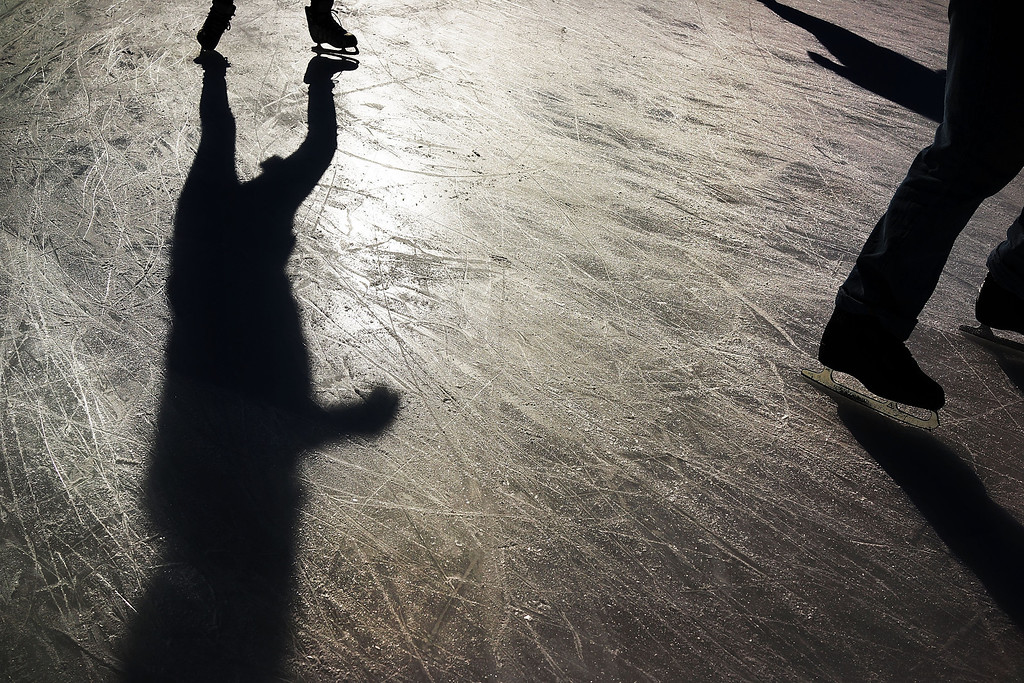Description of . People enjoy a new ice rink at the Samuel J. and Ethel LeFrak Center following a snow storm in Prospect Park January 4, 2014 in the Brooklyn borough of New York City. The major winter snowstorm named