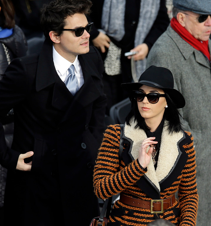 Description of . John Mayer and Katy Perry arrives for the ceremonial swearing-in of President Barack Obama at the U.S. Capitol during the 57th Presidential Inauguration in Washington, Monday, Jan. 21, 2013. (AP Photo/Carolyn Kaster)