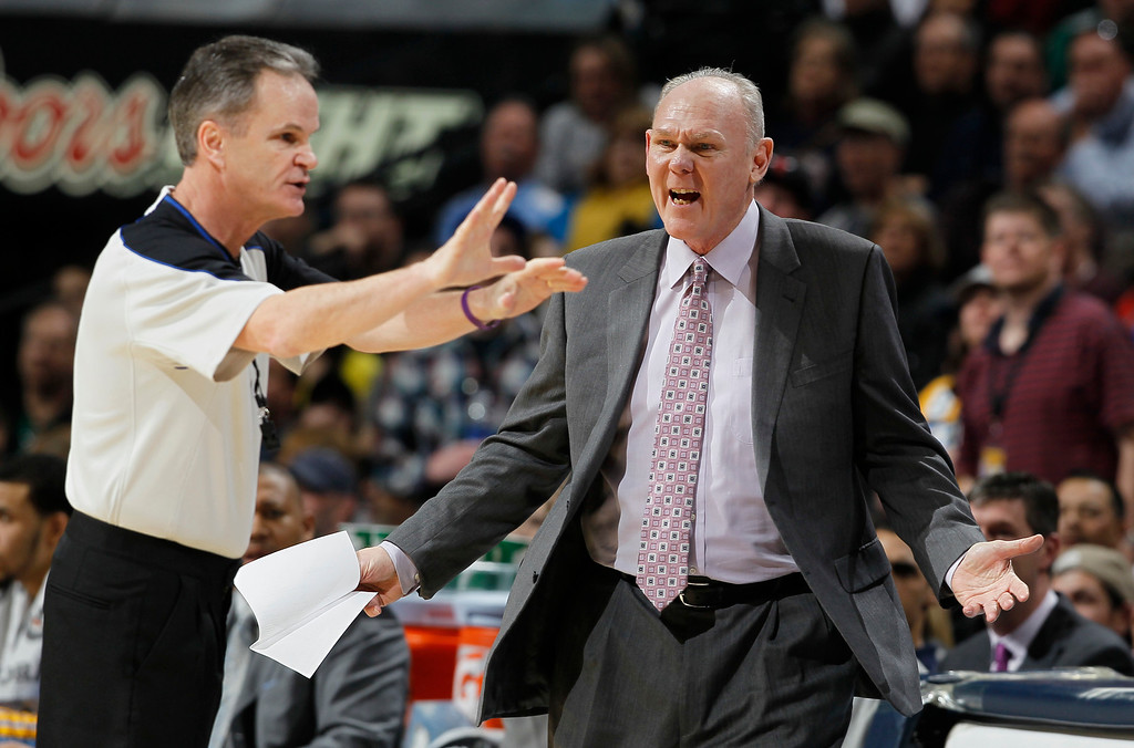Description of . Denver Nuggets coach George Karl, right, argues a call with referee Mike Callahan in the fourth quarter of the Nuggets' 97-90 victory over the Boston Celtics in an NBA basketball game in Denver on Tuesday, Feb. 19, 2013. (AP Photo/David Zalubowski)
