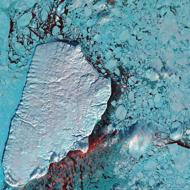 Description of . Akpatok Island, Canada Akpatok Island rises sharply out of the frigid water of Ungava Bay in northern Quebec, Canada. Composed primarily of limestone, the island is a flat, treeless plateau 23 kilometers wide, 45 kilometers long, and about 150 to 250 meters high. This 2001 Landsat 7 image shows Akpatok Island completely covered in snow and ice. Small, dark patches of open water appear between pieces of pale blue-green sea ice, and a few scattered clouds are shown in red. The surrounding sea and ice are home to polar bears, walruses, and whales. A traditional hunting ground for native Inuit people, Akpatok is almost inaccessible except by air. The island is an important sanctuary for seabirds that make their nests in the steep cliffs that circle the island.  NASA