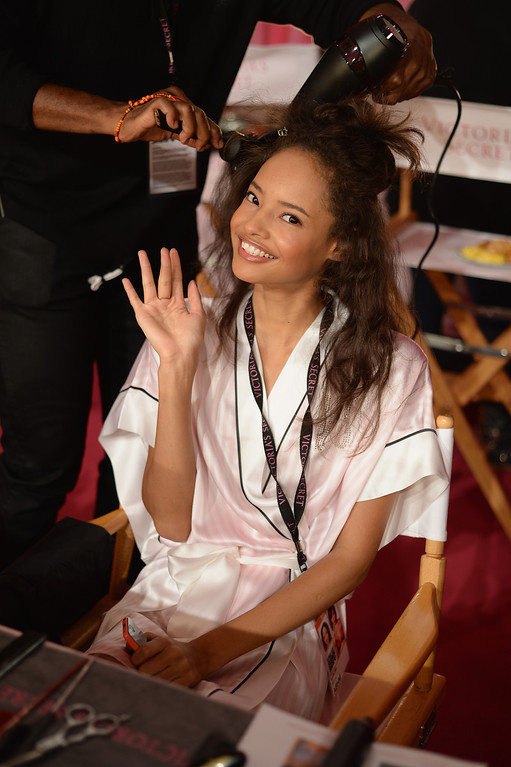Description of . Model Malaika Firth prepares at the 2013 Victoria's Secret Fashion Show hair and make-up room at Lexington Avenue Armory on November 13, 2013 in New York City.  (Photo by Dimitrios Kambouris/Getty Images for Victoria's Secret)