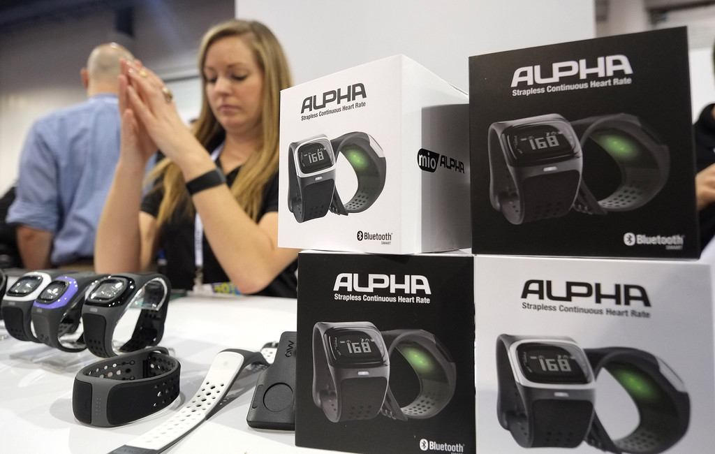 Description of . Alpha pulse heart beat measuring watches by MIO shown during the 2014 International CES at the Las Vegas Convention Center on January 8, 2014 in Las Vegas, Nevada. CES, the world's largest annual consumer technology trade show, runs through January 10 and is expected to feature 3,200 exhibitors showing off their latest products and services to about 150,000 attendees. AFP PHOTO/JOE KLAMAR/AFP/Getty Images