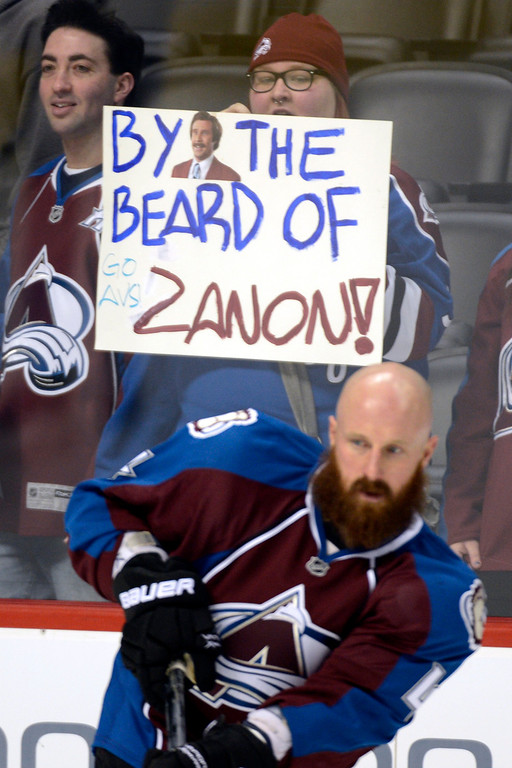 Description of . DENVER, CO. - JANUARY 22: Fans hold a sign praising the beard of Colorado Avalanche defenseman Greg Zanon (4) during the pre-skate of their first home game of the NHL season. The Colorado Avalanche hosted the Los Angeles Kings at the Pepsi Center on January, 22, 2013.    (Photo By John Leyba / The Denver Post)