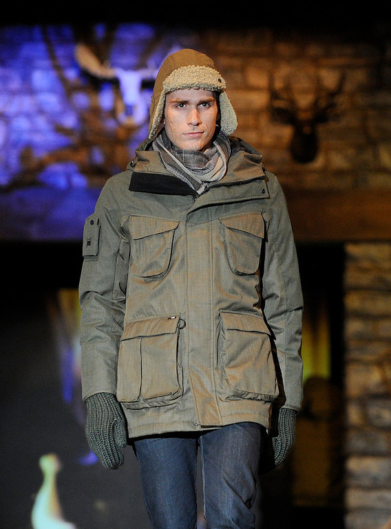 Description of . Nobis army green hooded jacket snow fashion as the SIA Snow Show hosted its 2013 Snow Fashion & Trends Show at the Colorado Convention Center  in downtown Denver  on Wednesday, January 30, 2013.  (Photo By Cyrus McCrimmon / The Denver Post)