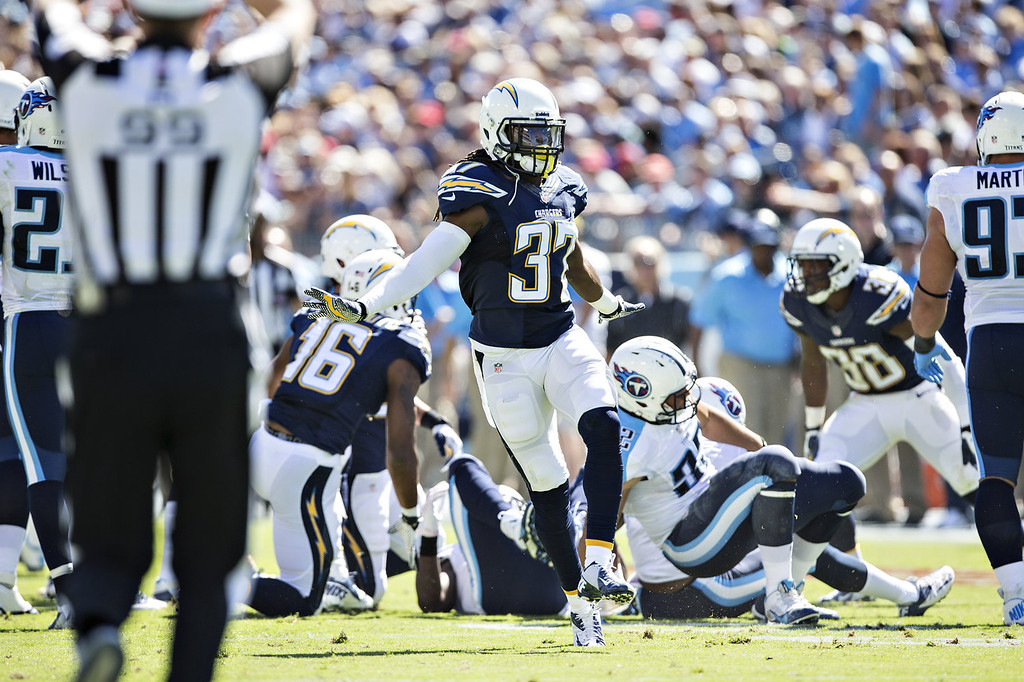 Description of . Jahleel Addae #37 of the San Diego Chargers celebrates after a big play against the Tennessee Titans at LP Field on September 22, 2013 in Nashville, Tennessee.  The Titans defeated the Chargers 20-17.  (Photo by Wesley Hitt/Getty Images)