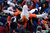 Miles, the Broncos mascot crowd surfs in the stands during the first quarter. The Denver Broncos vs Baltimore Ravens AFC Divisional playoff game at Sports Authority Field Saturday January 12, 2013. (Photo by Joe Amon,/The Denver Post)