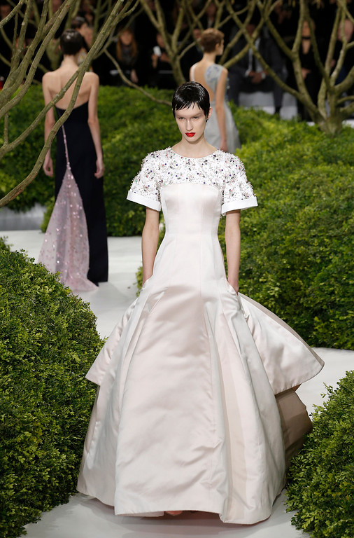 Description of . A model presents a creation by Raf Simons for Christian Dior's Spring Summer 2013 Haute Couture fashion collection, presented in Paris, Monday, Jan.21, 2013. (AP Photo/Christophe Ena)