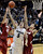University of Colorado's Eli Stalzer takes a shot over Rosco Allen, No. 12, and Dwight Powell, at right, during a game against Stanford on Thursday, Jan. 24, at the Coors Event Center on the CU campus in Boulder. Jeremy Papasso/ Camera