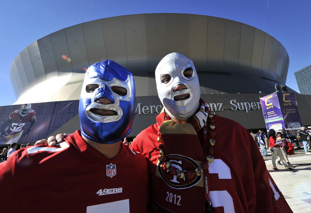 Description of . San Francisco 49ers fans pose before the start of Super Bowl XLVII between the San Francisco 49ers and the Baltimore Ravens on February 3, 2013 at the Mercedes-Benz Superdome in New Orleans.      TIMOTHY A. CLARY/AFP/Getty Images